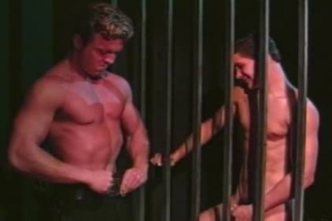 lustful Inmate Seduces Hunky Guard on Duty